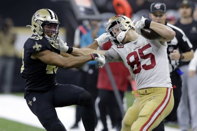 With seconds left on the clock, San Francisco 49ers tight end George Kittle (85) picks up 39 yards and a face mask penalty, putting the 49ers in position to kick the winning field goal as time expires Sunday at the Mercedes-Benz Superdome in New Orleans. Photo by AJ Sisco/UPI