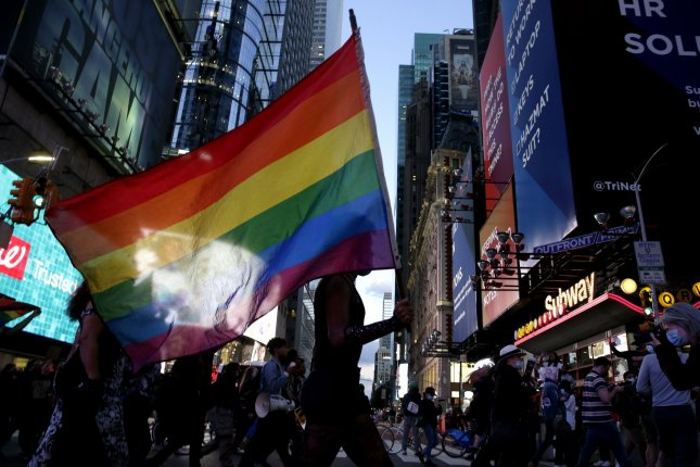 Activists hold rainbow flags as they march along Seventh Avenue in New York City during the People's March for Roxanne Moore on October 2, 2020. Moore a 29-year-old Black transgender woman, was shot 16 times by police. File Photo by John Angelillo/UPI