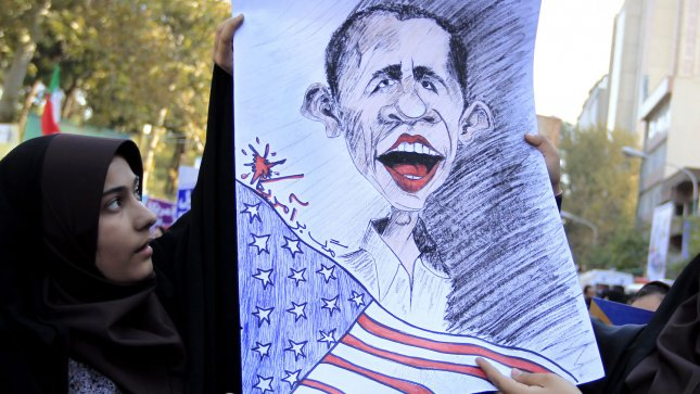Iranian students hold caricature of American President Barack Obama as they participate in a celebratory demonstration marking the 33rd anniversary of the capture of the American embassy by militant students in front of the former US Embassy in Tehran, Iran on November 2, 2012. UPI/Maryam Rahmanian