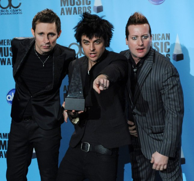 Green Day appears backstage after being named favorite alternative rock artist at the 37th annual American Music Awards in Los Angeles on November 22, 2009. UPI/Jim Ruymen