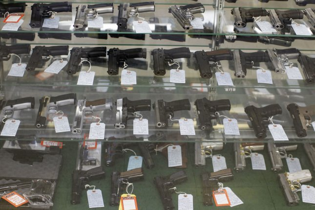 Various semiautomatic handguns are displayed in a case at G. A. T. Guns in Dundee, Illinois on June 28, 2010. (File/UPI/Brian Kersey)