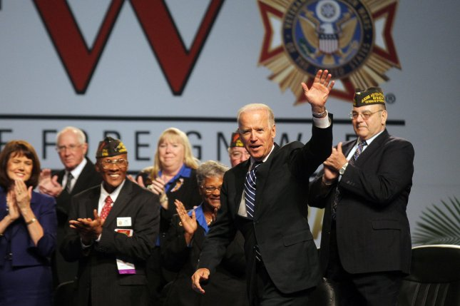 U.S. Vice President Joe Biden waves to the crowd as he enters the stage to deliver remarks to the Veterans of Foreign Wars National Convention at America's Center in St. Louis on July 21, 2014. UPI/Bill Greenblatt