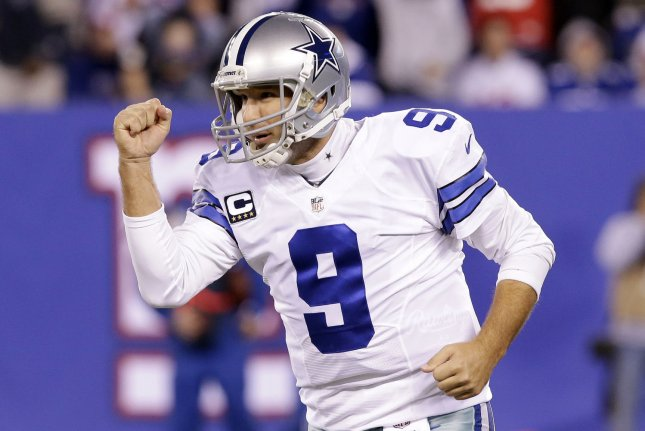 Dallas Cowboys QB Tony Romo reacts after throwing a 4-yard touchdown pass. File photo by John Angelillo/UPI