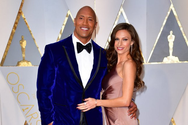 Dwayne Johnson and Lauren Hashian arrive on the red carpet for the 89th annual Academy Awards on February 26. Johnson has once again teased a fight between his DC cinematic character Black Adam and Henry Cavill's Superman. File Photo by Kevin Dietsch/UPI