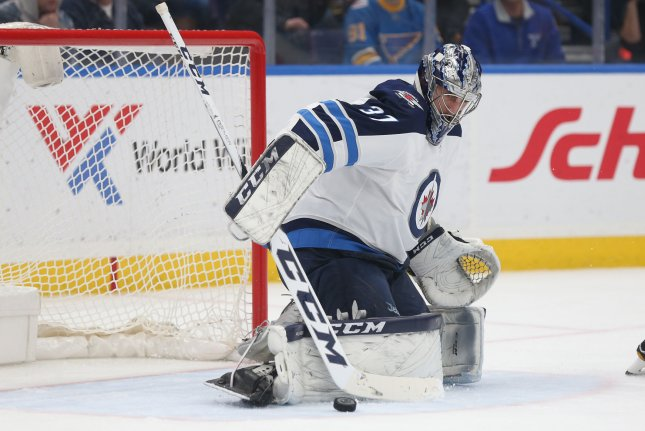 Winnipeg Jets goaltender Connor Hellebuyck pushes the puck aside after a shot by the St. Louis Blues in the first period on February 23, 2018 at the Scottrade Center in St. Louis. Photo by Bill Greenblatt/UPI