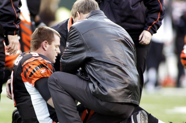 Cincinnati Bengals quarter Carson Palmer is assisted on the field after tearing his ACL against the Pittsburgh Steelers on January 8, 2006, at Paul Brown Stadium in Cincinnati, Ohio. File Photo by Stephen Gross/UPI