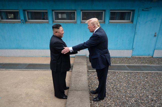 President Donald J. Trump shakes hands with Chairman of the Workers' Party of Korea Kim Jong Un on June 30, 2019, as the two leaders meet at the Korean Demilitarized Zone. White House Photo by Shealah Craighead/UPI