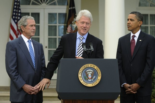 Former Presidents Bill Clinton, Barack Obama and George W. Bush said they're all willing to receive a coronavirus vaccine in some public fashion to encourage inoculation and reinforce trust among skeptical Americans. File Photo by Alexis C. Glenn/UPI
