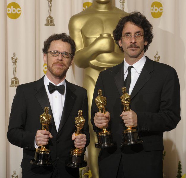 Directors Ethan Coen (L) and Joel Coen pose with their Oscars for best director and adapted screenplay for their work on 'No Country for Old Men' at the 80th Academy Awards in Hollywood on February 24, 2008. (UPI Photo/Phil McCarten)