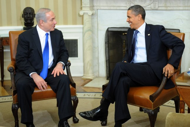 Israeli Prime Minister Binyamin Netanyahu (L) Monday presented President Obama a copy of the Book of Esther as background reading on Iran. UPI/Pat Benic