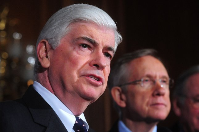 Sen. Chris Dodd, D-Conn., speaks alongside Senate Majority Leader Harry Reid, D-Nev., at a press conference on health care in Washington, Dec. 21, 2009. UPI/Kevin Dietsch
