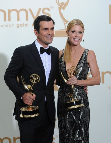Julie Bowen and Ty Burrell hold the awards for their outstanding supporting roles for Modern Family at the 63rd Primetime Emmy Awards at the Nokia Theatre in Los Angeles on September 18, 2011. UPI/Jayne Kamin Oncea
