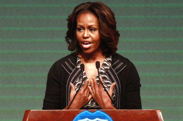U.S. First Lady Michelle Obama talks with students at the No. 7 High School in Chengdu, the capital of Shaanxi Province, on March 25, 2014. (UPI/Stephen Shaver)