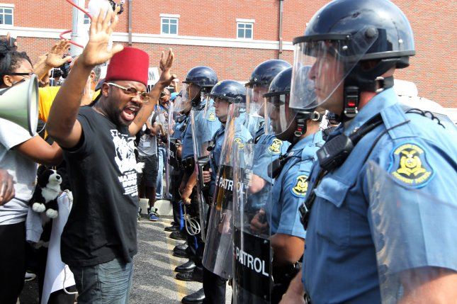 Protesters are greeted by a line of Missouri State Police during a protest march on the police station in Ferguson, Missouri on August 11, 2014. People are protesting the police shooting of the unarmed black teenager Michael Brown on August 9, 2014. Rioting and looting took place in the community on August 10. UPI/Bill Greenblatt