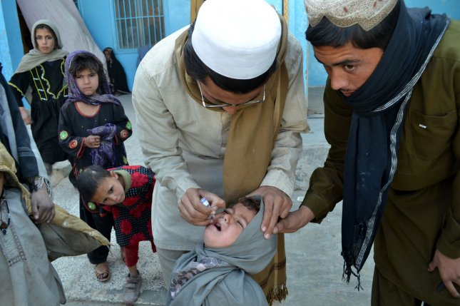 A health worker administers a polio vaccine to a child during a three day nationwide vaccination campaign to eradicate polio, in the civil hospital in the Pakistani border town, Chaman, along the Afghanistan border, Jan. 20, 2014. A UNICEF report says some 68 million doses of the polio vaccine were distributed in 2014. File photo by Matiullah/UPI