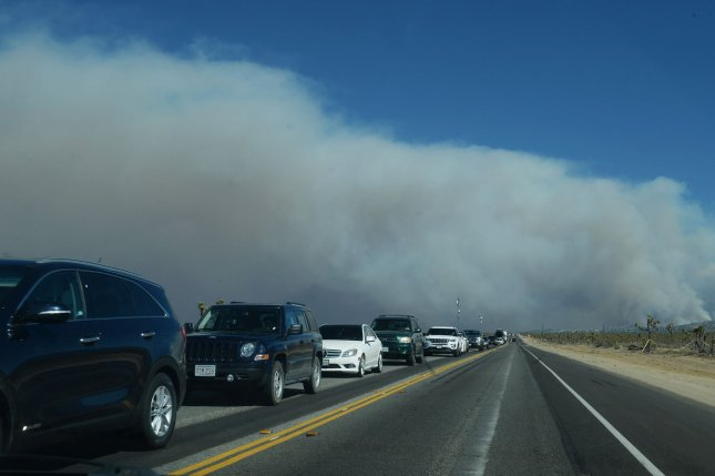 Cars and trucks are rerouted from a massive wildfire in Southern California. Photo by Jim Ruymen/UPI