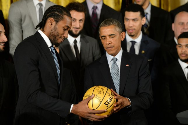 San Antonio Spurs player Kawhi Leonard, pictured here with President Barack Obama, scored 31 points as the San Antonio Spurs topped the Minnesota Timberwolves 105-91 on Tuesday, December 6, 2016, at Target Center to improve to 13-0 on the road. File Photo by Pat Benic/UPI