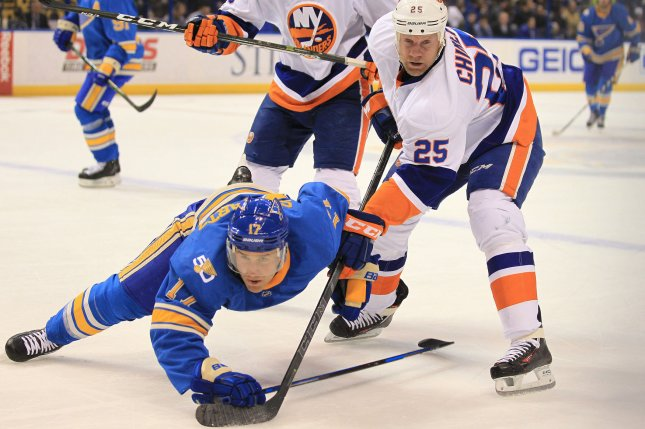 New York Islanders Jason Chimera forces St. Louis Blues Jaden Schwartz to the ice in the first period at the Scottrade Center in St. Louis on March 11, 2017. Photo by Bill Greenblatt/UPI