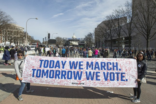 Demonstrators walk in the March for Our Lives rally on Pennsylvania Avenue in Washington, D.C., on March 24. Data show younger adults have contributed to a surge in voter registrations nationwide since the shooting attack at a South Florida high school. File Photo by Mark Wallheiser /UPI
