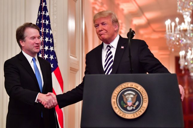 President Donald Trump shakes hands with Supreme Court Associate Justice Brett Kavanaugh after his ceremonial swearing-in ceremony at the White House on Monday. Photo by Kevin Dietsch/UPI