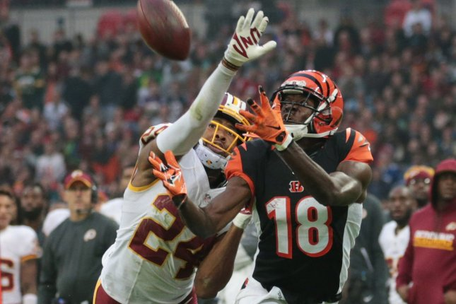Cincinnati Bengals wide receiver A.J. Green (18) attempts to make a catch against the Washington Redskins on October 30, 2016 at Wembley Stadium in London. File photo by Hugo Philpott/UPI