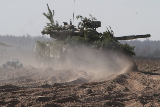 Ukrainian army tank participates in a military exercise near Goncharovsk village of the Chernigov area in Ukraine on March 14, 2014. Russian troops have gathered near the Ukraine border for exercises as the standoff continues over Crimea. UPI/Sergey Starostenko