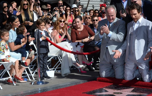 Actor McConaughey reacts as his wife, actress Camila Alves and their children, Levi Alves McConaughey, Vida Alves McConaughey and Livingston Alves McConaughey look on during an unveiling ceremony honoring him with the 2,534th star on the Hollywood Walk of Fame in Los Angeles on November 17, 2014. UPI/Jim Ruymen