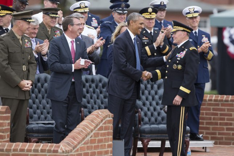 U.S. President Barack Obama congratulates General Martin Dempsey during Dempsey's retirement ceremony at Fort Myer, Virginia, September 25, 2015. Pool photo by Chris Kleponis/UPI