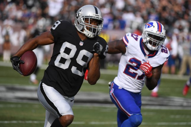 Oakland Raiders receiver Amari Cooper (89) runs with the ball pursued by Buffalo Bills' James Ihedigbo in the first quarter at the Oakland Coliseum in Oakland, California on December 4, 2016. File photo by Terry Schmitt/UPI