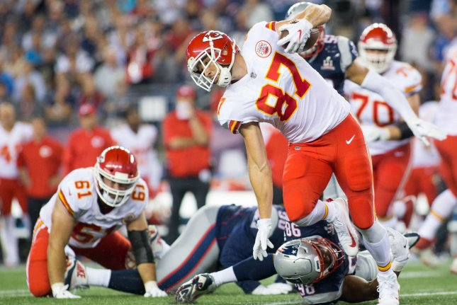 Kansas City Chiefs tight end Travis Kelce (87) dodges a tackle by New England Patriots defensive tackle Trey Flowers (98) on a seven-yard reception in the third quarter on September 7 at Gillette Stadium in Foxborough, Mass. Photo by Matthew Healey/ UPI