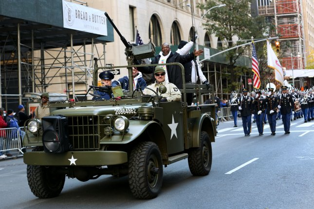 Veterans ride in a World War II Jeep as they participate in the Veterans Day Parade on Fifth Avenue on Sunday. Photo by Monika Graff/UPI