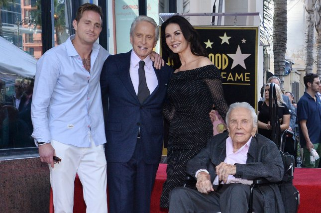 Catherine Zeta-Jones (second from right), pictured with Cameron Douglas, Michael Douglas and Kirk Douglas (L-R), dedicated a sweet post to Kirk on his birthday. File Photo by Jim Ruymen/UPI