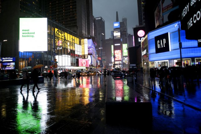 Rain falls in Times Square in Manhattan, New York City, on November 26. More rain is expected in the Northeast in the coming days. Photo by John Angelillo/UPI