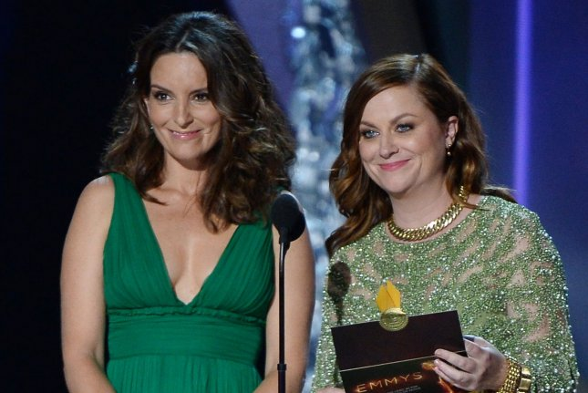 Tina Fey (L) and Amy Poehler speak onstage during the 68th annual Primetime Emmy Awards on September 2016. The Hollywood Foreign Press Association announced that Golden Globe nominations will be announced on Feb. 3. File Photo by Jim Ruymen/UPI