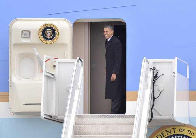 U. S. President Barack Obama boards Air Force One for departure from Austin Straubel International Airport in Green Bay, Wisconsin on January 26, 2011. President Obama, Vice President Joe Biden and other members of the President's Cabinet traveled across the country Wednesday to highlight the administration's efforts to rebuild the American economy. UPI/Brian Kersey