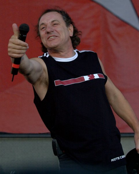 TOR2003073016-TORONTO, Ontario, Canada, July 30 (UPI)-- Brian Johnson, lead singer of AC/DC, salutes the crowd of 500,000 for their support at the SARS-relief concert at Downsview Park in Toronto, Canada on July 30, 2003. Headliners the Rolling Stones take the stage later tonight. cc/cc/Christine Chew UPI