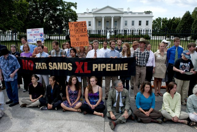 Members of the activist group Sojourners protest the Keystone Tar Sans Pipeline in front of the White House in Washington on August 23, 2011. UPI/Kevin Dietsch