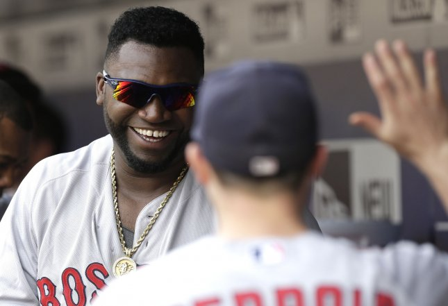 Boston Red Sox first baseman/DH David Ortiz smiles in the dug out in 2015. File photo by John Angelillo/UPI