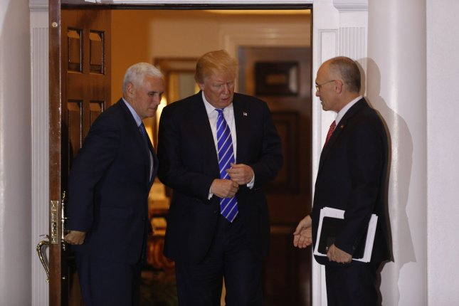 Andrew Puzder (R), chief executive of CKE Restaurants, leaves the clubhouse of Trump International Golf Club in Bedminister, N.J., after meeting with President-elect Donald Trump (C) and Vice President-elect Mike Pence (L) on November 20. Trump is expected to nominate Puzder as secretary of labor. Pool Photo by Peter Foley/UPI