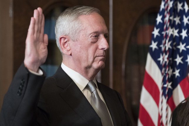 Former Marine Corps Gen. James Mattis is sworn-in as defense secretary by Vice President Mike Pence in the ceremonial office in the Executive Office Building in Washington, D.C., on Friday. Photo by Kevin Dietsch/UPI