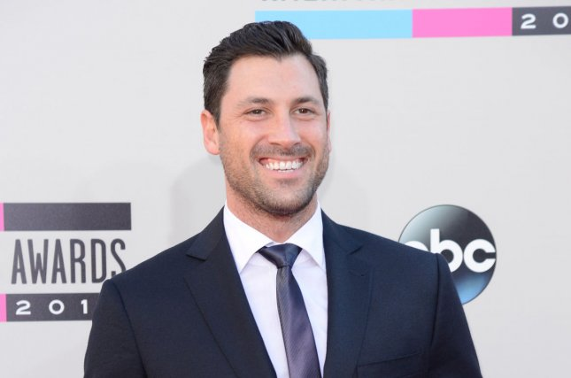Maksim Chmerkovskiy arrives for the 41st annual American Music Awards in Los Angeles on November 24, 2013. Chmerkovskiy is recovering from calf surgery this week. File Photo by Phil McCarten/UPI