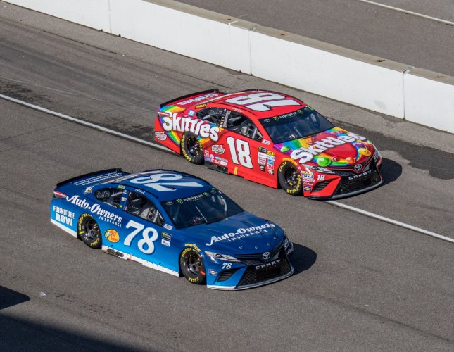 Martin Truex Jr (78) and Kyle Busch race off pit row during the 2017 Brickyard 400 in July. Photo by Edwin Locke/UPI