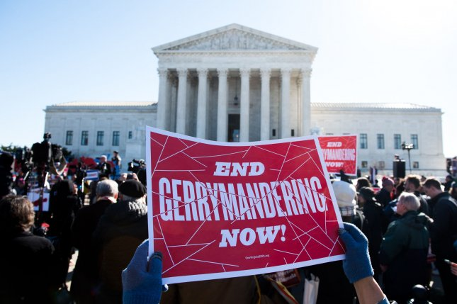 A demonstrator attends a rally against gerrymandering and fair election maps outside of the Supreme Court on March 26. The high court ruled Monday that the Viriginia House of Delegates lacked standing in its gerrymandering case. Photo by Kevin Dietsch/UPI