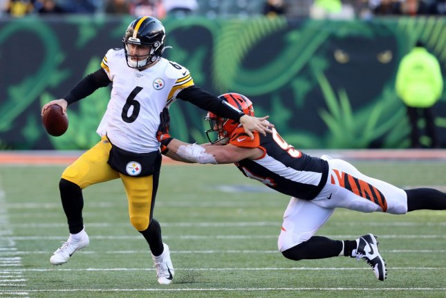 Pittsburgh Steelers quarterback Devlin Hodges (6) fights to break free from Cincinnati Bengals defender Sam Hubbard (94) during the second half of play Sunday at Paul Brown Stadium in Cincinnati, Ohio. Hodges replaced Mason Rudolph at quarterback in the game. Photo by John Sommers II/UPI