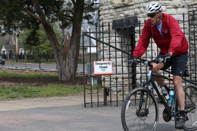 Although signage is in place, a bike rider enters Tillis Park in Ladue, Mo. on Friday. Photo by Bill Greenblatt/UPI