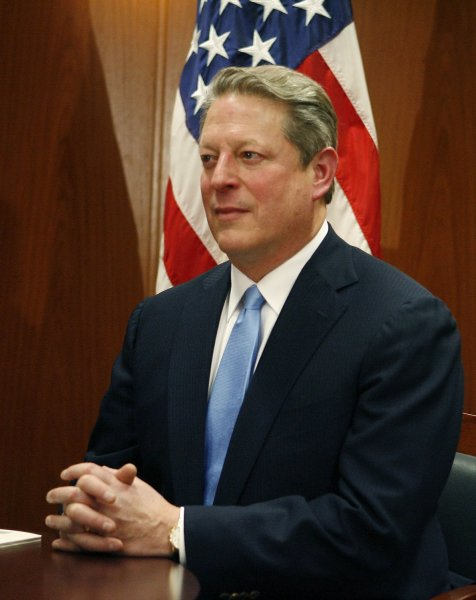 Former Vice President Al Gore sits after a private meeting with President-elect Barack Obama and Vice President-elect Joe Biden at Obama's transition office in Chicago on December 9, 2008. An Obama spokesman said the three men discussed energy and climate change and how policies in those areas could help the economy. (UPI Photo/Brian Kersey/POOL)