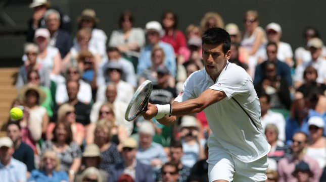 Serbia's Novak Djokovic reurns against Germany's Florian Mayer on the second day of the 2013 Wimbledon Championships in London on June 25, 2013. UPI/Hugo Philpott