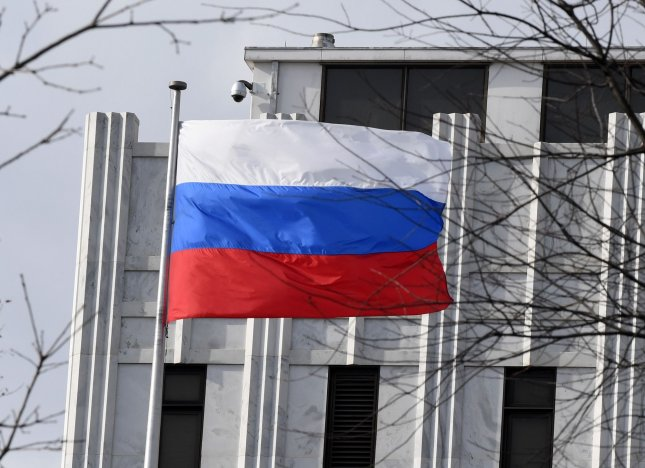 The Russian flag flies at the Russian Embassy in Washington, D.C. on December 30. Kremlin spokesman Dmitry Peskov said Tuesday that economic sanctions against Russia would not stop dialogue between the United States and Russia. Photo by Pat Benic/UPI
