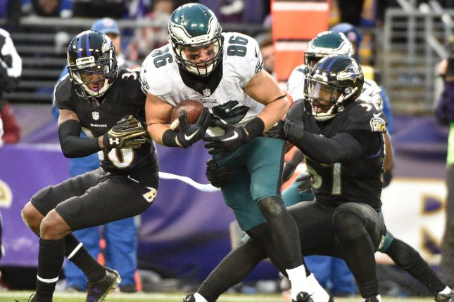 Philadelphia Eagles tight end Zach Ertz (86) is stopped on a short gain by Baltimore Ravens defenders Tavon Young (L) and C.J. Mosley (R) during the second half of an NFL game at M&T Bank Stadium in Baltimore, Maryland, December 18, 2016. Baltimore won 27-26. Photo by David Tulis/UPI