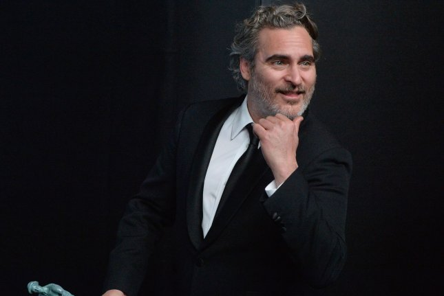 Joaquin Phoenix with his award for Outstanding Performance by a Male Actor in a Leading Role for Joker in Los Angeles on January 19. Next year's SAG Awards ceremony is to take place on March 14, 2021. File Photo by Jim Ruymen/UPI